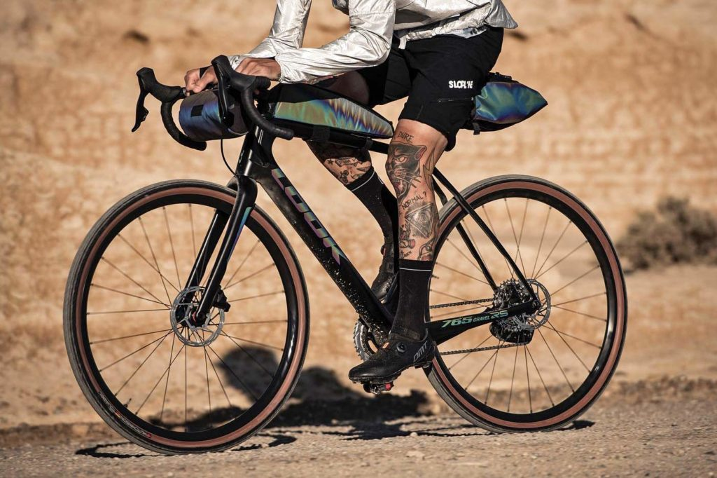 1633719343_Look-X-Restrap-limited-edition-iridescent-gravel-bike-and-bikepacking-bags_riding-NDS-1024x682.jpg